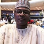 Buhari fires Abeshi, appoints Babandede as Acting Immigration boss