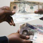 Economic crisis may worsen as naira hits 390/dollar