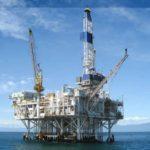 Oil prices slide on supply glut warning