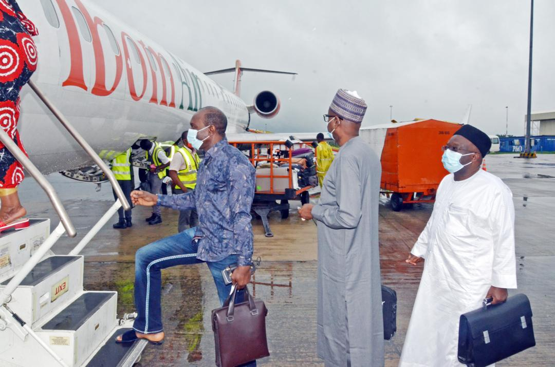 Hon. Minister of State for Petroleum Resources, Chief Timipre Sylva, Group Managing Director of Nigerian National Petroleum Corporation (NNPC), Mallam Mele Kyari (middle), boarding an IbomAir aircraft from Uyo, Akwa Ibom State, after a meeting of the Board of the NNPC held in Uyo on Saturday 22 August, 2020. In front of the GMD is NNPC Chief Operating Officer , Upstream ,, Mr. Adokiye Tombomieye.