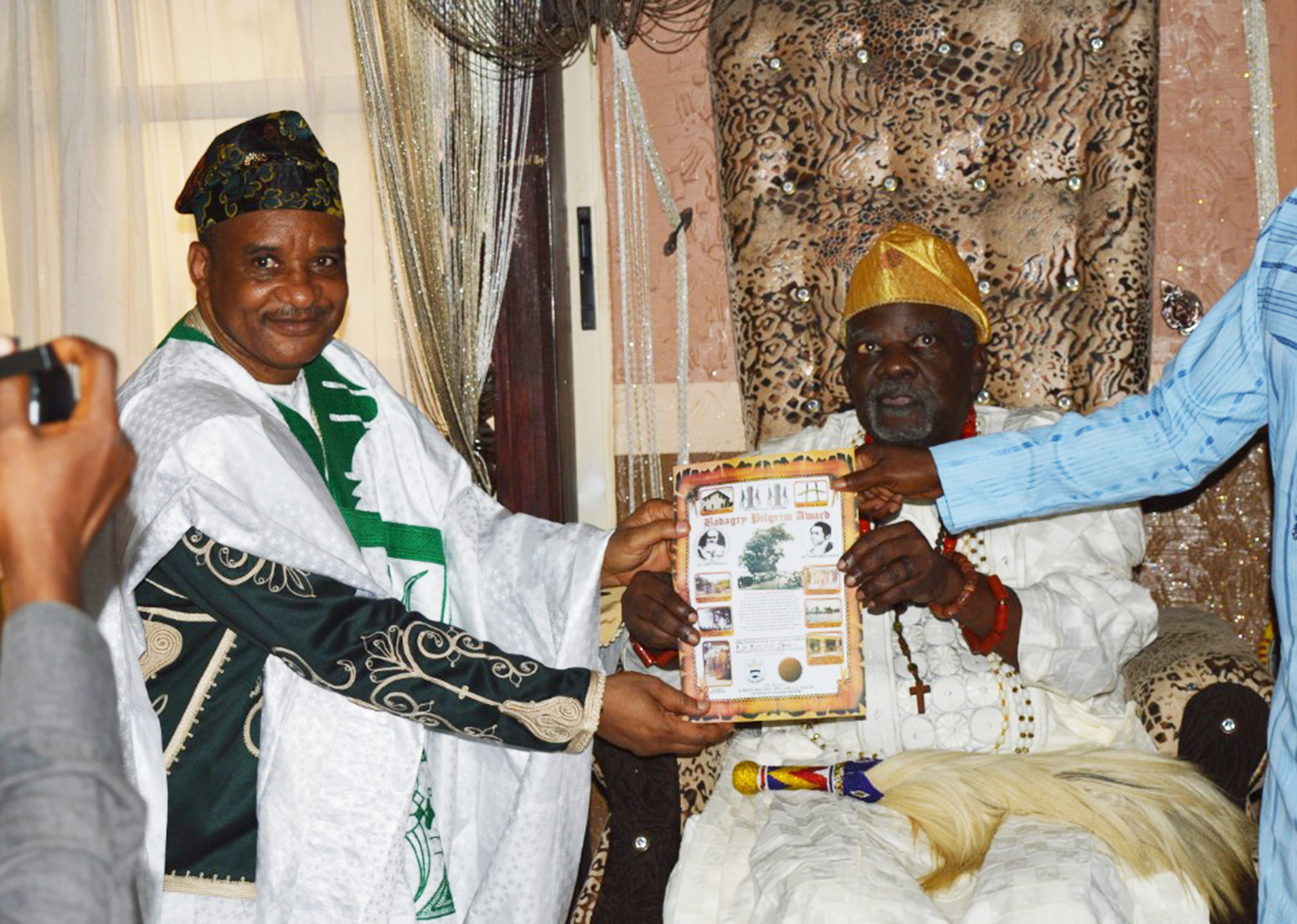 DG, NIMASA Dr. Bashir Jamoh (L) receiving a plaque from theAkran of Badagry, His Royal Majesty, De-Wheno Aholu Menu Toyi 1, during the NIMASA DG, visit to the paramount ruler of Badagry on New year's Day.