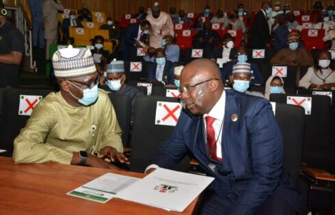 Minister of State for Petroleum Resources, Chief Timipre Sylva, and NNPC GMD, Mallam Mele Kyari, conferring during the launch of the Nigerian Upstream Cost Optimisation Programme (NUCOP).