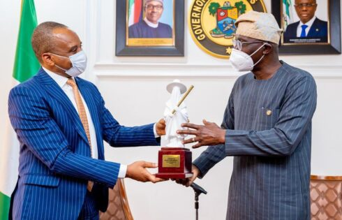 Lagos State Governor Babajide Sanwo-Olu (right) making a presentation to the DG, NIMASA, Dr. Bashir Jamoh, when the DG paid a courtesy visit to Government House, Alausa-Ikeja, recently.