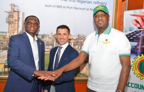 L-R, Chief Operating Officer, Refineries and Petrochemicals, Engr Mustapha Yakubu, representative of Techimont S.P.A. ( the contractor), Mr. Masu Alberto  and Managing Director, Port Harcourt Refining Company, Engr Ahmed Dikko pledging to make the rehabilitation project a success...Thursday.