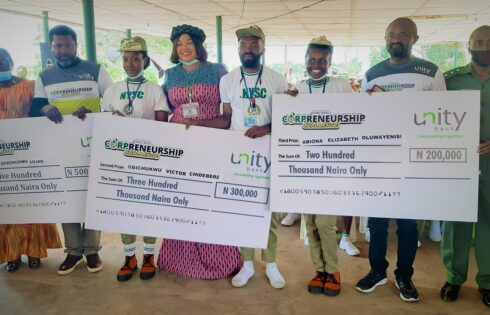 :L-R:Mrs. Jane Okpongette, Assistant Director, Corps Inspection and Monitoring; Mr. DeVoe Okorie, Head Brand Marketing & Communications, Unity Bank Plc; Agu Ogechukwu Lilian, Overall Winner of Corpreneurship Challenge; Mrs. Chinyere Ekwe, NYSC Akwa Ibom State Coordinator; Victor Obichukwu Chidebere, Second place winner of the Corpreneurship Challenge; Abiona Elizabeth Oluwayenisi, third place winner of the Corpreneurship Challenge; Mr. Etop Ukpe, Uyo Regional Manager, Unity Bank Plc and Captain Atawodi S.A, NYSC Akwa Ibom Camp Commandant during the cheque presentation to winners of Corpreneurship Challenge at Akwa Ibom NYSC Orientation camp recently.