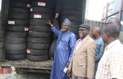 L-R: Director, Inspectorate and Compliance Department,SON, Mr Mark manady Dakhling; Deputy director,ICD,Engr. Enebi shua'ib Onuche;and ICD,officer,Engr. Tsonatu Theophilus,during the evacuation of substandard tyres at a whare house in Ogun state,
