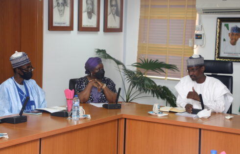 Chairman of the Nigeria Deposit Insurance Corporation (NDIC) Board of Directors, Mrs Ronke Sokefun (Centre) and NDIC MD/CE, Bello Hassan (1st Left) listen intently as the Honourable Minister of the FCT, Mal. Musa Bello (1st Right) makes his remarks during the NDIC Board's visit to the FCT Ministry in Abuja.