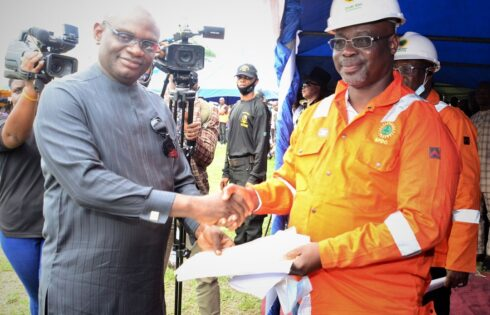 Convener and leader of the Ogoni Liberation Initiative, Rev. Douglas Fabeke (left), presenting a communique from the Ogoni leaders to the Managing Director, Nigerian Petroleum Development Company (NPDC), Mr. Mohammed Ali-Zarah, who was invited as guest to the Ogoni Liberation Day celebration which held in Bori, Rivers State.