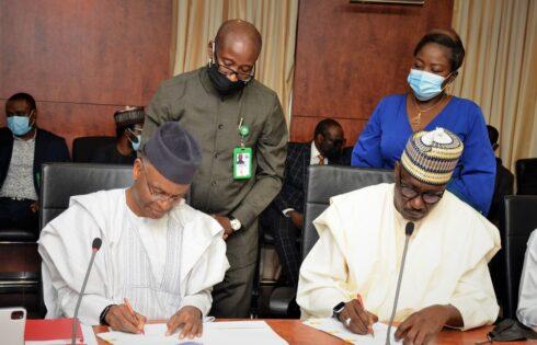 R-L,GMD NNPC,Mallam Mele Kyari and Kaduna State Governor, Nasir  el-Rufai signing the MOU for the supply of gas to Kaduna State