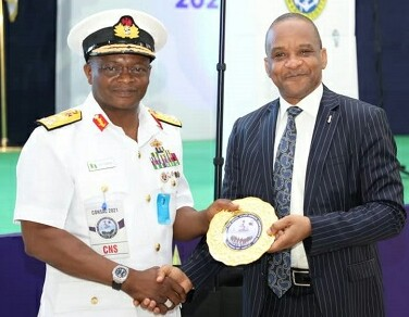 Chief of Naval Staff, Vice Admiral Awwal Zubairu Gambo presents an award to the DG of NIMASA, Dr. Bashir Jamoh for enhancing civil-military cohesion towards promoting maritime security at the just concluded CNS Conference in Kano.