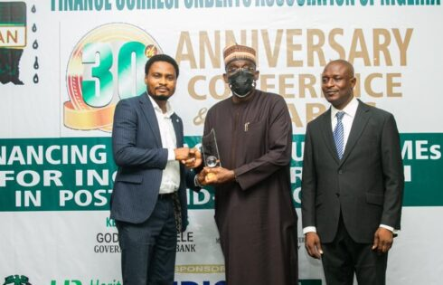 L-R: Blaise Udunze, Team Lead Media and External Relations of Heritage Bank Plc; former Managing Director of Bank of Industry, Waheed Olagunju and the Chairman of Finance Correspondents Association of Nigeria, Titus Nwokoji, during the presentstion of the duo Platinum Awards to Ifie Sekibo and Heritage Bank.