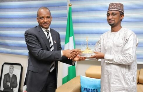 From left: DG, NIMASA, Dr Bashir Jamoh, presents a plaque to the DG, of  NiMet, Professor Mansur Matazu, who paid him a courtesy visit at the agency's headquarters in Lagos, recently.