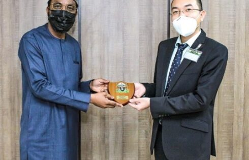 From left: Acting Managing Director of the Nigerian Ports Authority, NPA, Mohammed Bello-Koko ( Left), presents the authority's plaque to the Managing Director, Lekki Port, Du Ruogang during a working visit to the NPA's Marina, Lagos corporate headquarters.