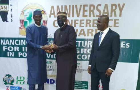 NDIC's Director, Communication & Public Affairs, Mr Bashir Nuhu (Left) receiving Award of Special Recognition for Support to Finance Correspondents Association of Nigeria (FICAN) and Financial Journalism in Nigeria on behalf of NDIC MD/CE from former MD, Bank of Industry, Dr. Waheed Olagunju while FICAN President, Chima Nwokoji watches in admiration yesterday in Lagos.
