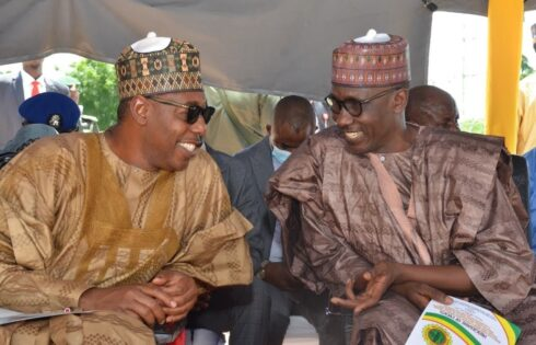 L-R: Gov. Zulum of Borno State in a chat with the GMD NNPC. Mrle Kyari at the groundbreaking ceremony of the Maiduguri & Environs Emergency Power, MEPP